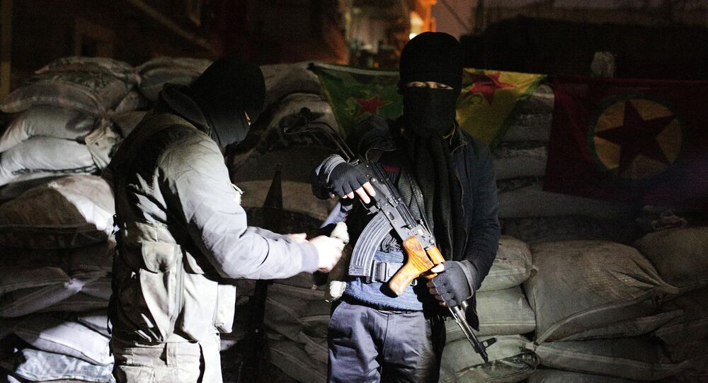 The militants of the Kurdistan Workers' Party, or PKK, stand at a barricade.