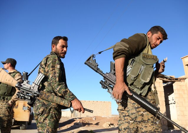 Fighters from the Syrian Democratic Forces (SDF) coalition