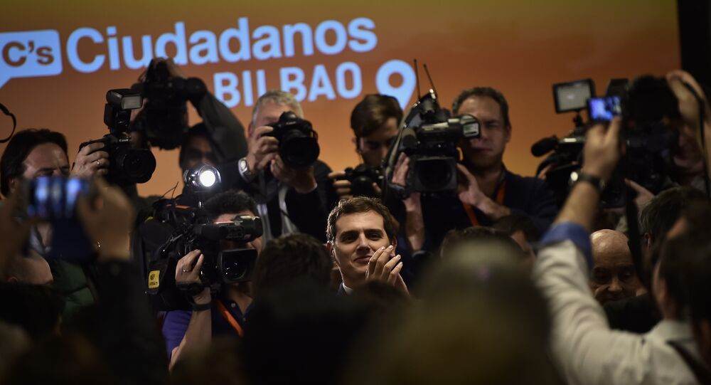 Albert Rivera, center, leader of the Spanish party Ciudadanos of Citizenz, center, applauds his followers during an electoral campaign meeting ahead of the national election in Bilbao, northern Spain