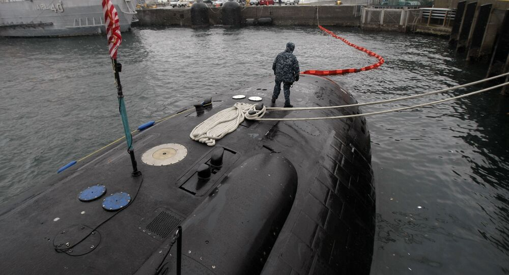 Crew member patrols on the USS Charlotte, a nuclear powered attack submarine, at the Yokosuka Naval Base, south of Tokyo. (File)