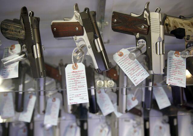 Handguns in a display case at Metro Shooting Supplies, in Bridgeton, Mo.
