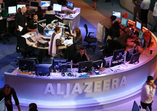 A general view shows the newsroom at the headquarters of the Qatar-based Al-Jazeera satellite channel in Doha