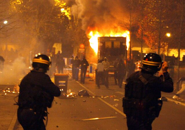 Riot police face young residents of Villiers-le-Bel, a northern Paris suburb