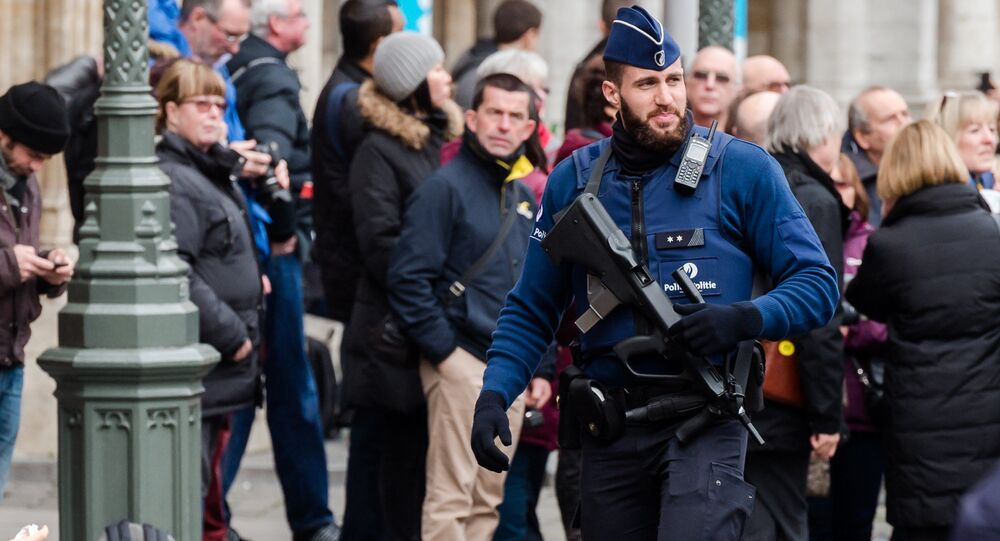 An armed police man patrols at the Grand Place in Brussels on Tuesday, Dec. 29, 2015.