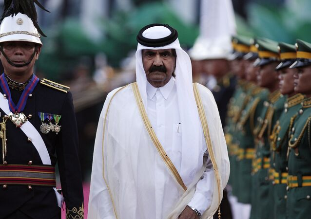 Sheikh Hamad Bin Khalifa Al-Thani, walks beside Philippine troopers during arrival honors at the Malacanang palace in Manila, Philippines on Tuesday April 10, 2012.