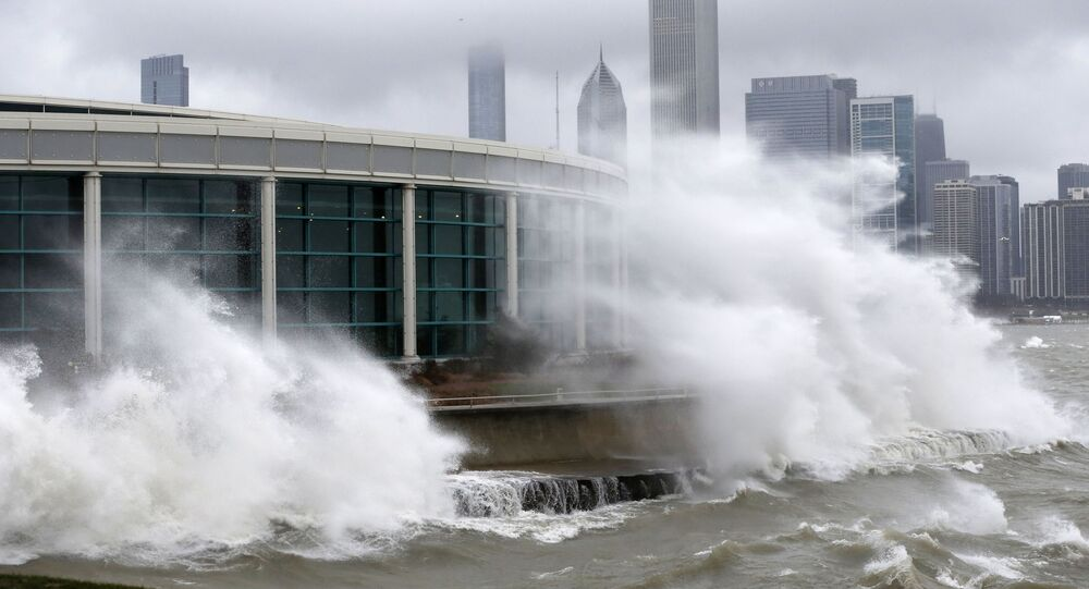 Wind blown waves from Lake Michigan break around the Shedd Aquarium as a winter storm moves across Illinois in Chicago