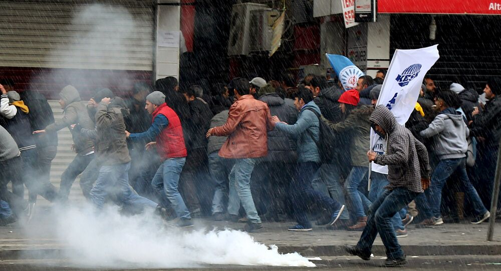 Turkish riot police use water cannons and tear gas to disperse Kurdish demonstrators during a protest against the curfew in Sur district and security operations, in the southeastern city of Diyarbakir, Turkey