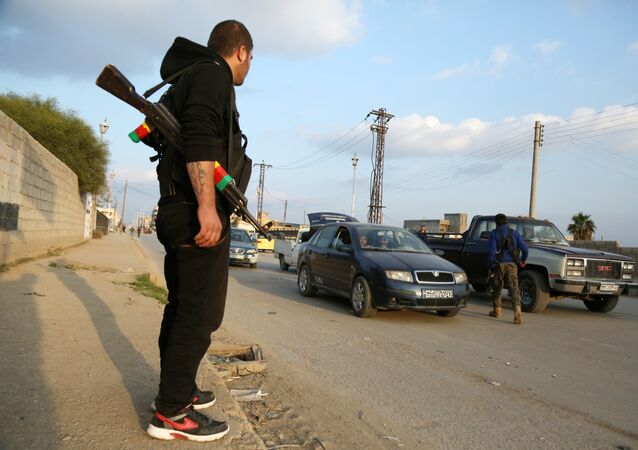 Members of the Kurdish internal security forces (known as the Asayish) check vehicles on December 16, 2015