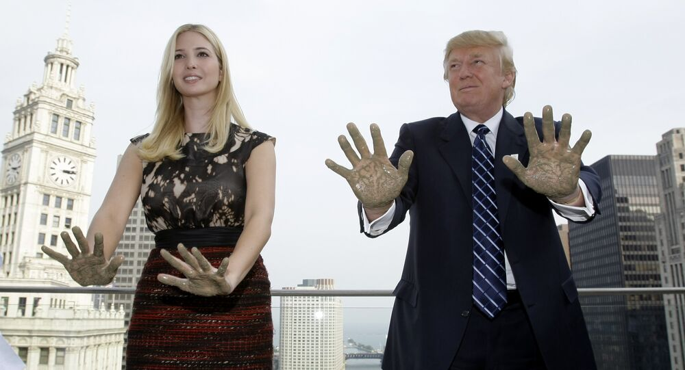 Real estate developer Donald Trump and his daughter Ivanka place their hands in concrete during topping off festivities for the 92-story Trump International Hotel and Tower in Chicago, Wednesday, Sept. 24, 2008.