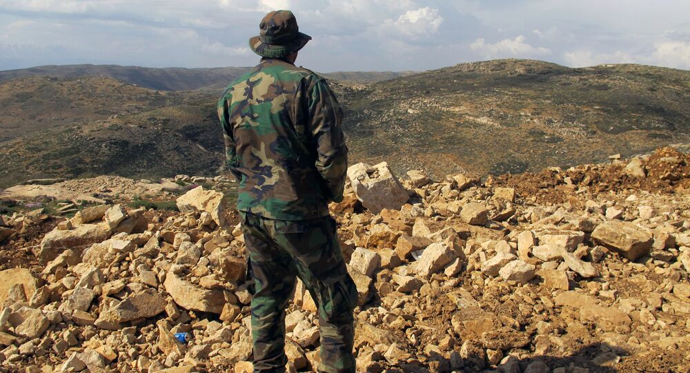 Hezbollah fighter looks toward Syria while standing in the fields of the Lebanese border village of Brital, Lebanon. (File)
