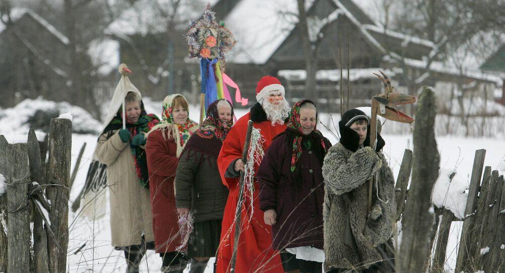 Local residents celebrating the Slavic Christmas holiday of Kolyada in the village of Pogost in Gomel Region, Belarus