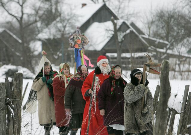 Local residents celebrating the Slavic Christmas holiday of Kolyada in the village of Pogost in Gomel Region, Belarus