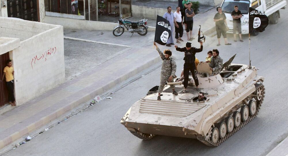 Militant Islamist fighters take part in a military parade along the streets of northern Raqqa province in this June 30, 2014, file photo