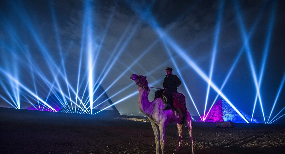 An Egyptian policeman riding a camel stands guard during New Year celebrations in front of the pyramids near the Egyptian capital Cairo on January 1, 2016