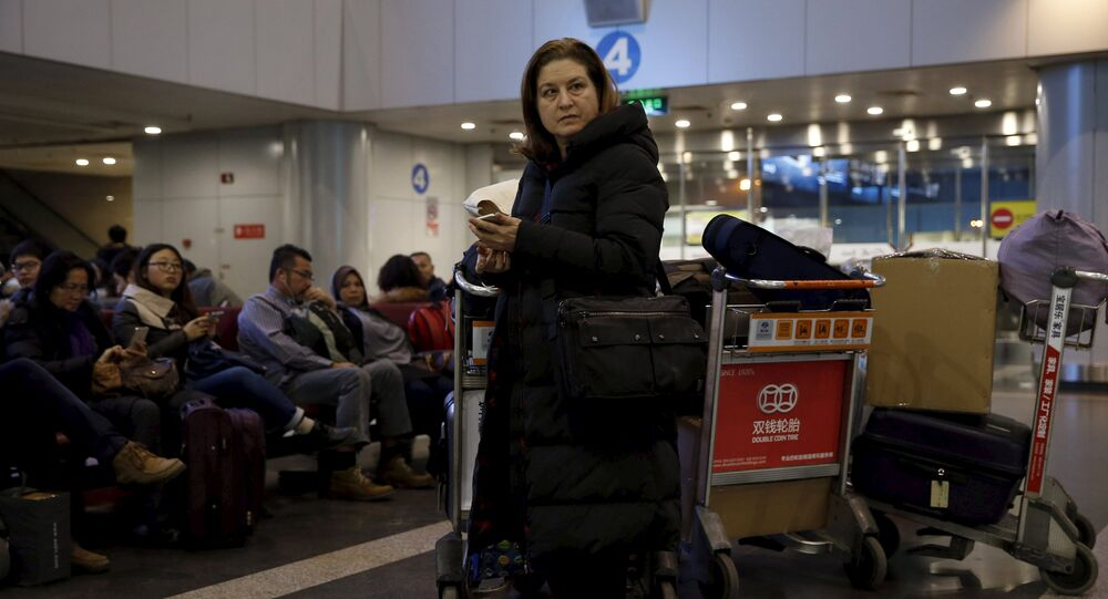 Ursula Gauthier, a reporter for the French current affairs magazine L'Obs, waits at Beijing international airport before her departure to France, in Beijing December 31, 2015