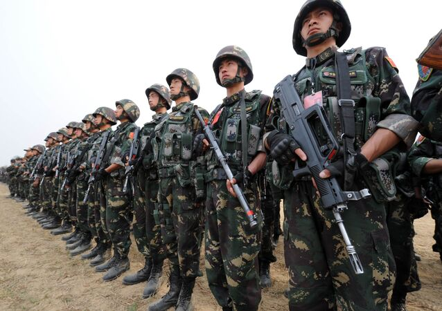 In this photograph taken on November 24, 2011 Chinese People's Liberation Army (PLA) soldiers take part in the Pakistan-China anti-terrorist drill as they wrap up their two-week military exercise in Jhelum, 85 kilometres southeast of Islamabad
