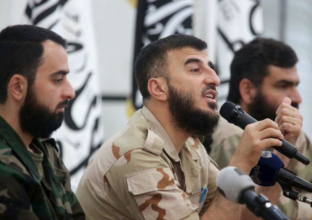 Zahran Alloush (C), commander of Jaysh al Islam, talks during a conference in the town of Douma, eastern Ghouta in Damascus, Syria August 27, 2014