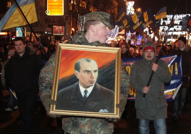 A man carrying a picture of Stepan Bandera during a torchlight procession of Ukrainian nationalists in downtown Kiev. File photo