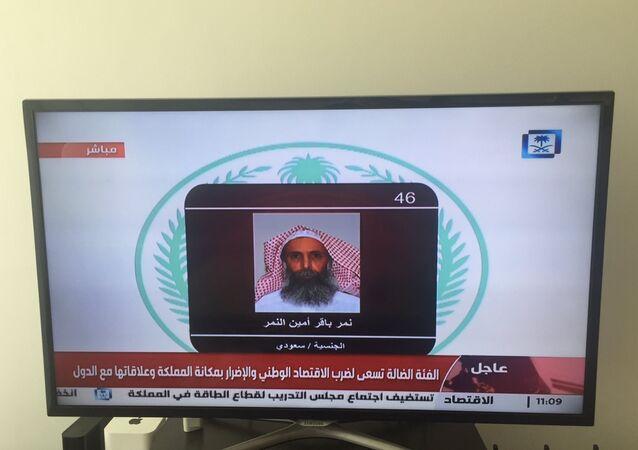 Saudi Arabia's state television channel displays an image of Sheikh Nimr al-Nimr, Saturday, Jan. 2, 2016, Dubai