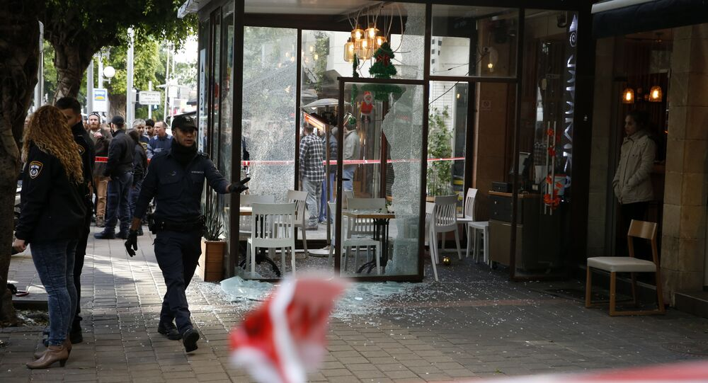 Members of the Israeli security forces cordon off the area following an attack by an unidentified gunman, who opened fire at a pub in the Israeli city of Tel Aviv killing two people and wounding five others on January 1, 2016, police and medical officials said