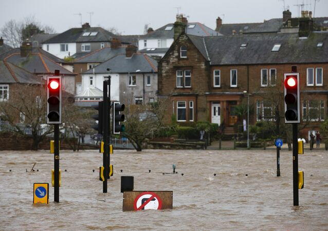 A flooded street is pictured in Dumfries, Scotland December 30, 2015