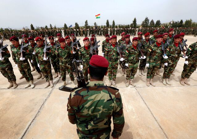 Kurdish Peshmerga fighters take part in a graduation ceremony on April 16, 2015 at the Kurdistan Training Coordination Center (KTTC) of Arbil, the capital of the autonomous Kurdish region of northern Iraq.