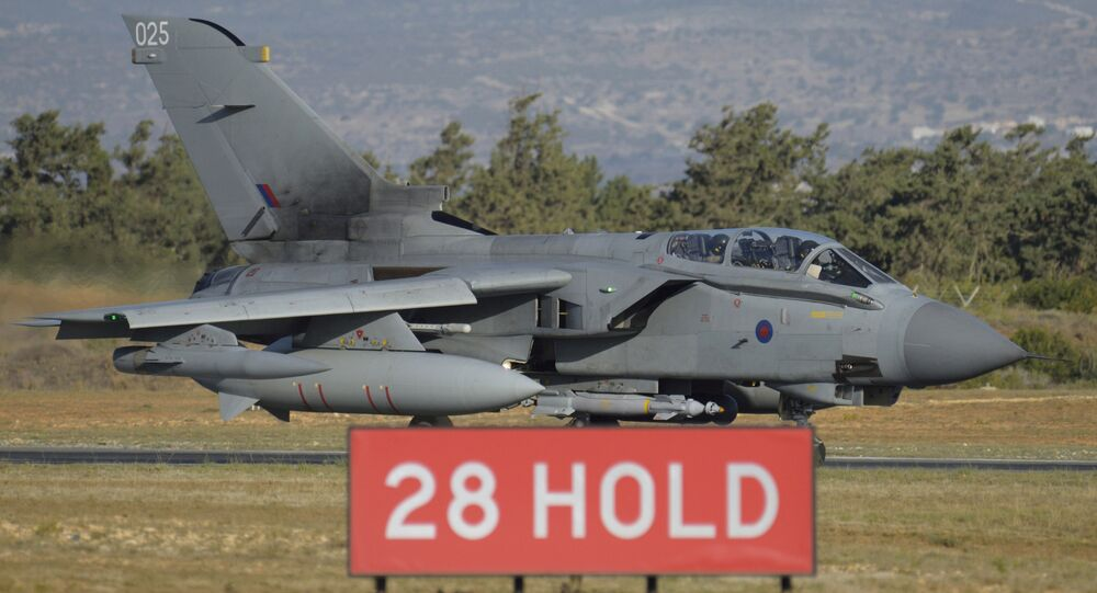 British tornado warplane passes on the runway at the RAF Akrotiri, a British air base near costal city of Limassol, Cyprus, Thursday, Dec. 3, 2015 after an airstrike. British warplanes carried out airstrikes in Syria early Thursday, hours after Parliament voted to authorize air attacks against Islamic State group targets there