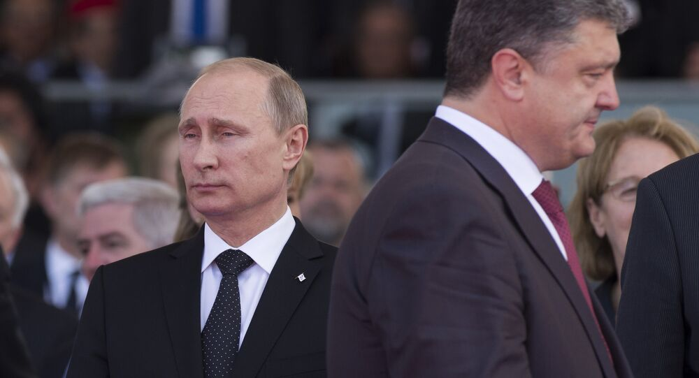 June 6, 2014. President Vladimir Putin (left) and Ukrainian President-Elect Petro Poroshenko during the celebrations of the 70th anniversary of the allied landing in Normandy