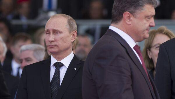 June 6, 2014. President Vladimir Putin (left) and Ukrainian President-Elect Petro Poroshenko during the celebrations of the 70th anniversary of the allied landing in Normandy - Sputnik International