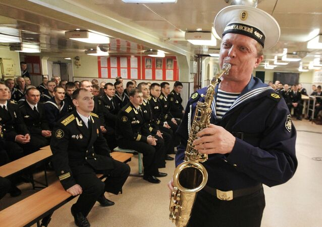 Honored Artist of Russia Andrei Klimovich performs during a concert held by the Pacific Fleet Song and Dance Ensemble for the crew of the Guards missile cruiser Varyag.