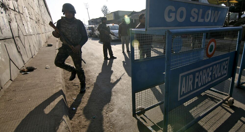 Indian security personnel stand guard next to a barricade outside the Indian Air Force (IAF) base at Pathankot in Punjab, India, January 2, 2016