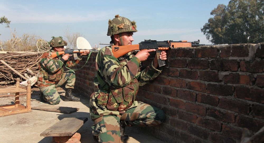 Indian army soldiers take positions on a rooftop of a building outside the Indian airbase in Pathankot, 430 kilometers (267 miles) north of New Delhi, India, Saturday, Jan. 2, 2016