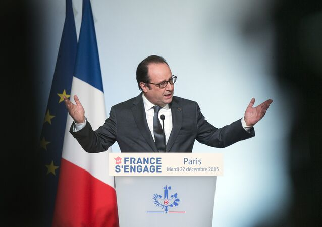 French President Francois Hollande delivers a speech during the La France s'engage (France makes a stand) award ceremony at the Elysee presidential palace in Paris on December 22, 2015