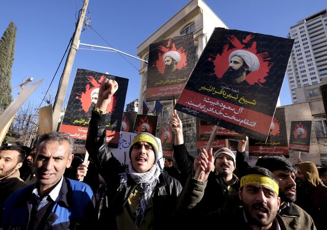 Iranian protesters chant slogans as they hold pictures of Shi'ite cleric Sheikh Nimr al-Nimr during a demonstration against the execution of Nimr in Saudi Arabia, outside the Saudi Arabian Embassy in Tehran January, 3, 2016