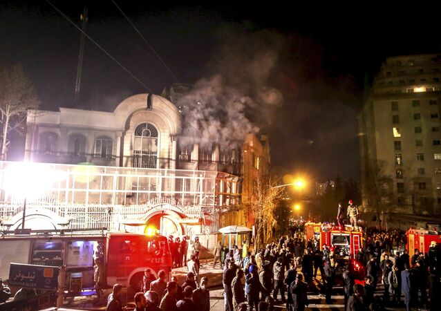 Flames rise from Saudi Arabia's embassy during a demonstration in Tehran January 2, 2016