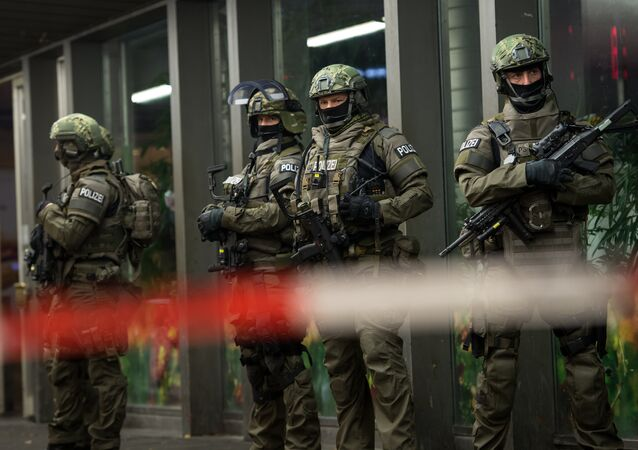 German special police stand in front of the Munich, southern Germany, main train station Thursday evening, Dec. 31, 2015 after police warned of 'imminent threat' of terror attack and ordered two train stations to be cleared
