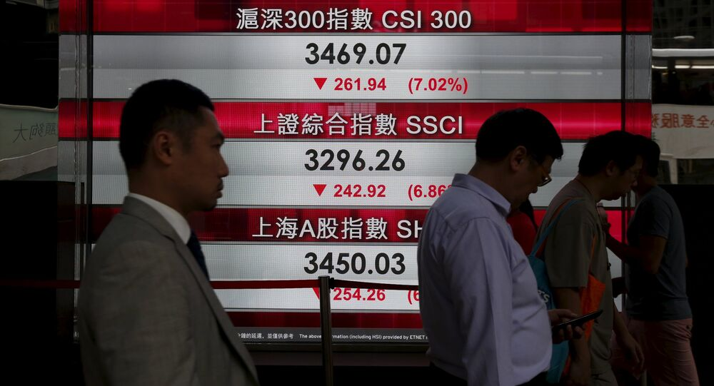 People walk past a panel displaying Chinese stock market indexes in Hong Kong, China January 4, 2016