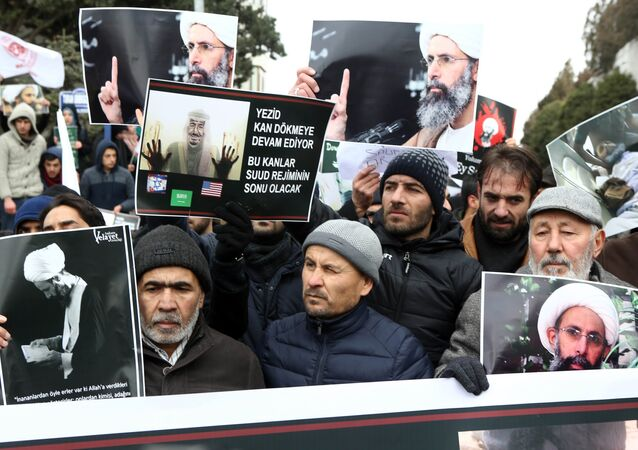 Iranian and Turkish demonstrators hold pictures of Shiite cleric Sheikh Nimr al-Nimr as they protest outside the Saudi Embassy in Ankara, on January 3, 2016, to protest against the execution by Saudi Arabia of a prominent Shiite cleric which they saw as a deliberate sectarian aggression