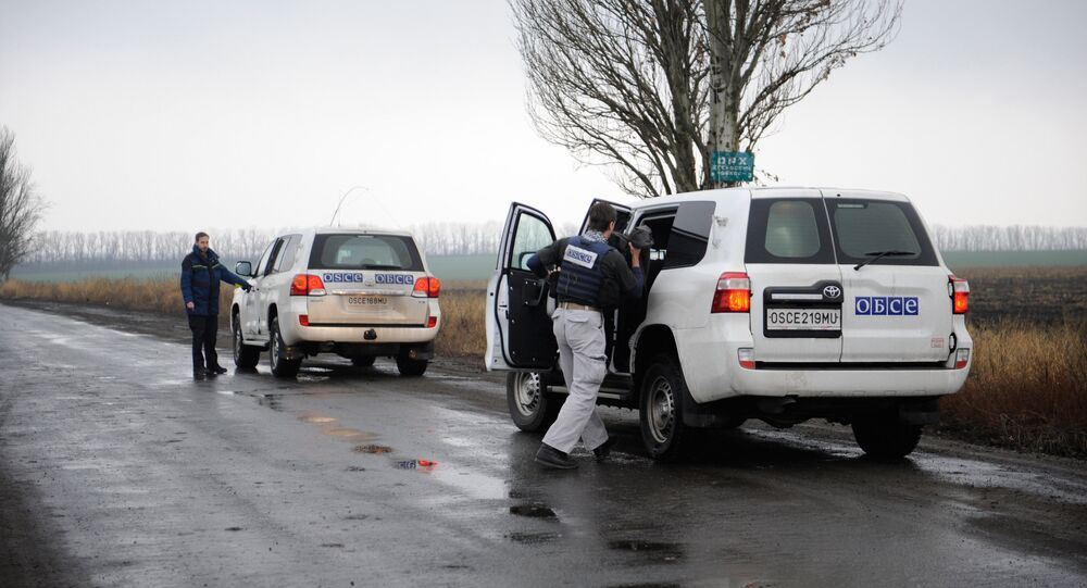 OSCE monitoring mission observers near the village of Zaichenko, Donetsk Region