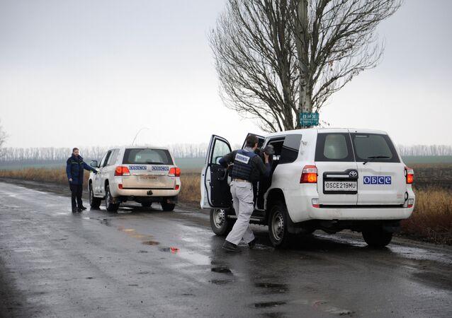 OSCE monitoring mission observers near the village of Zaichenko, Donetsk Region