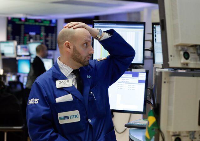 Specialist Meric Greenbaum works on the floor of the New York Stock Exchange, Monday, Jan. 4, 2016
