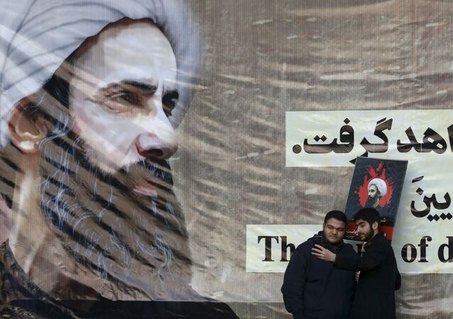 Iranian men take a selfie with a poster of Sheikh Nimr al-Nimr, a prominent opposition Saudi Shiite cleric, who was executed last week by Saudi Arabia.