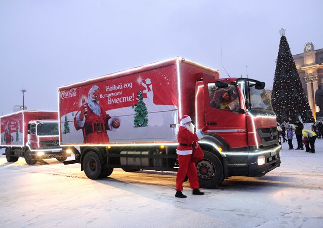 The caravan of Coca-Cola Christmas trucks on the square in front of the Oktyabrsky district administration in Samara