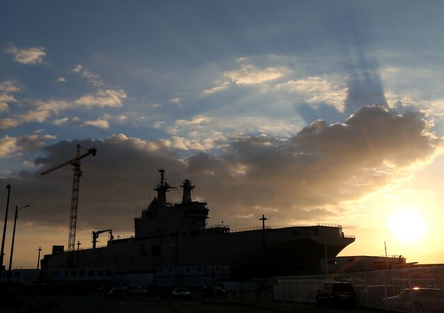 A Mistral-class warships dock at Saint-Nazaire harbor.