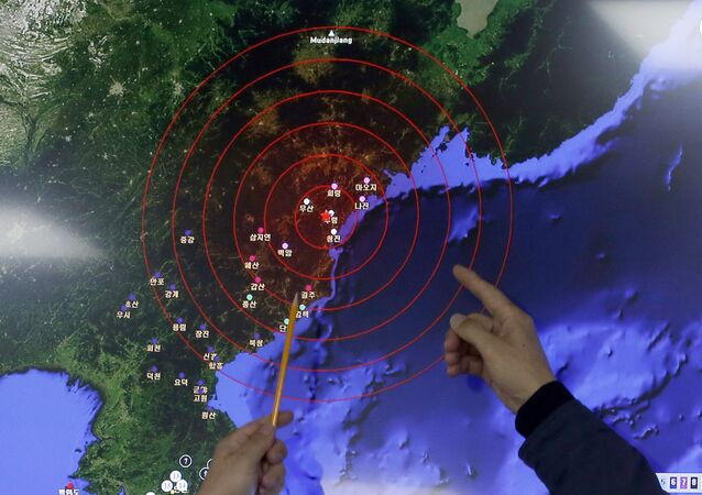 Officers from the Korea Meteorological Administration point at the epicenter of seismic waves in North Korea, at the National Earthquake and Volcano Center of the Korea Meteorological Administration in Seoul, South Korea, Wednesday, Jan. 6, 2016.