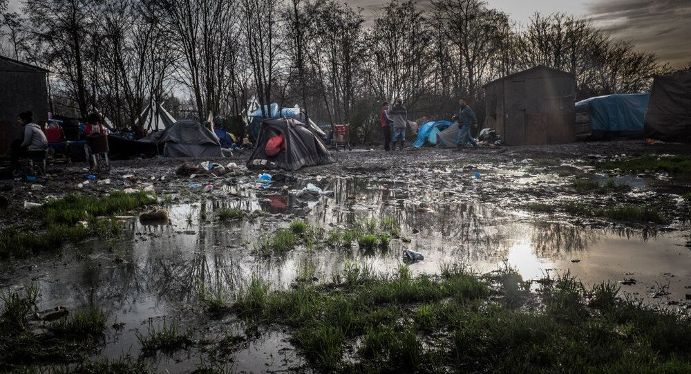 Dunkirk refugee camp surrounded by mud and puddles.
