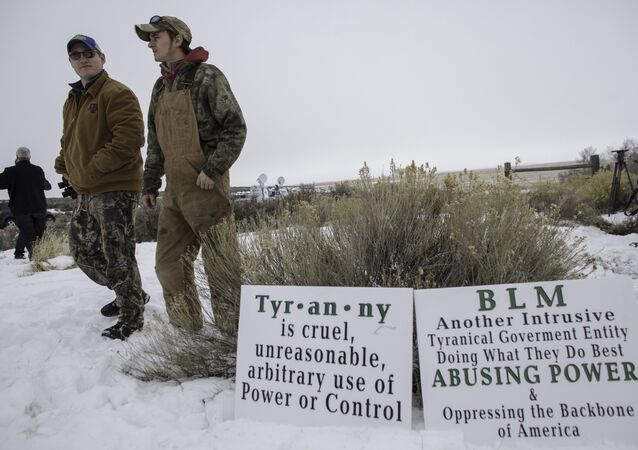Members of an armed militia, monitor the entrance to the Malheur National Wildlife Refuge Headquarters near Burns, Oregon.