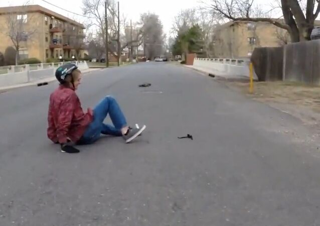 Longboarder Falls While Weaving In and Out Read.