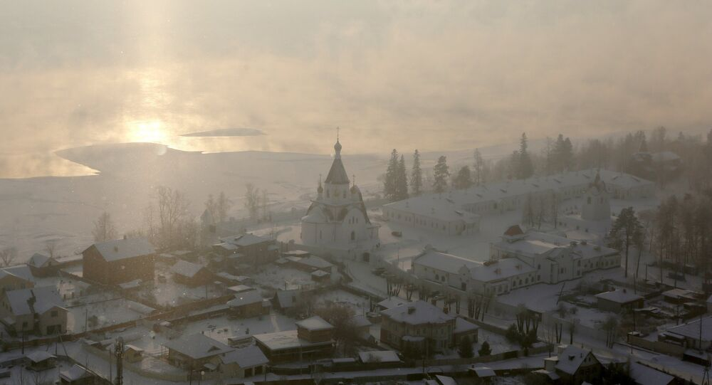 A view through a frosty fog shows the Uspensky male monastery, with the air temperature at about minus 26 degrees Celsius (minus 14.8 degrees Fahrenheit) on the eve of Orthodox Christmas in the vicinity of the Siberian city of Krasnoyarsk, Russia