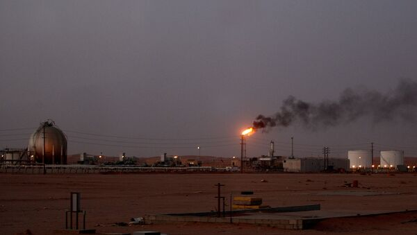 A flame from a Saudi Aramco (the national oil company) oil installation known as Pump 3 burns brightly during sunset in the Saudi Arabian desert near the oil-rich area Al-Khurais, 160 kms east of the capital Riyadh - Sputnik International